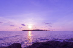 Sunset over island Stock Images