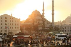 Sunset over Istanbul crowded square near the sea port with view on mosques. Istanbul, Turkey - 2 November 2014 - Sunset over Istanbul crowded square near the sea Royalty Free Stock Images