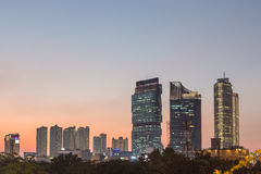 Sunset over Jakarta business district Stock Photo