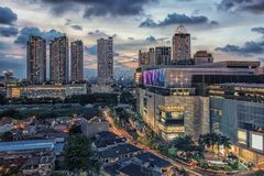Jakarta city capital of Indonesia. Sunset over Jakarta city downtown stock photo