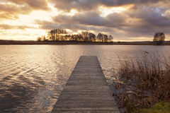 Sunset over jetty on the Elbe river Royalty Free Stock Images