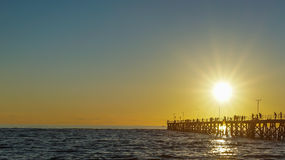 People standing on the jetty to enjoy the sunset, Brighton Beach, South Australia. People standing on the jetty to enjoy the sunset Royalty Free Stock Photo