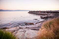 Sunset over Juan de Fuca Strait, Ogden Point, Victoria, BC Royalty Free Stock Image