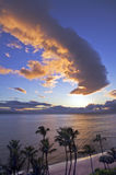 Sunset over Kaanapali Beach in. Sunset casts a golden glow over the ocean at Kaanapali Beach on Maui stock photography