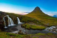 Sunset over the Kirkjufellsfoss Waterfall with Kirkjufell Mountain stock photography