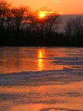 Sunset over Kishwaukee River. Sunset over frozen backwaters of the Kishwaukee River in northern Illinois Stock Photography