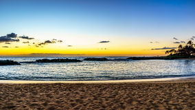 Sunset over the lagoon and beach under blue sky on the West Coast of Oahu Royalty Free Stock Photography