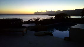 Sunset. Over the lagoon mountain in the back ground stock photos
