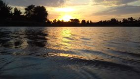 Sunset over the lake & x28;Закат над озером& x29; royalty free stock photography