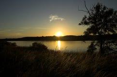 Sunset over lake. Sunset over wooded lake Royalty Free Stock Image
