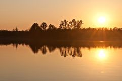 Sunset over lake. And forest Royalty Free Stock Photography