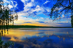 Sunset over lake. The lake reflected the clouds at sunset Royalty Free Stock Photography