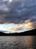 Sunset over the lake. With mountains in the background royalty free stock photos