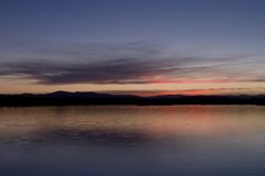 Sunset over a Lake. Sunet over the Brindabella Mountains, Canberra Stock Photos