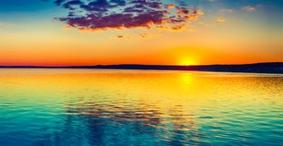 Sunset over the lake. Amazing panorama landscape Royalty Free Stock Images