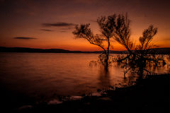 Sunset over the lake in autumn. Ozark sunset at Greers ferry lake in heber springs arkansas royalty free stock image