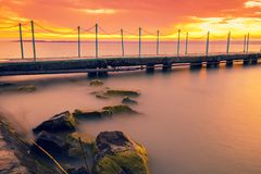 Unset over lake Balaton, Hungary. Sunset over lake Balaton, Hungary, Europe. Wooden pier in the town of Siofok stock photo