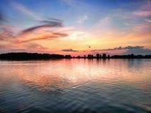Sunset over the lake. Beautiful sunset over the lake Stock Photo