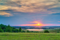 Sunset over lake. Beautiful sunset over lake in a countryside Royalty Free Stock Photo