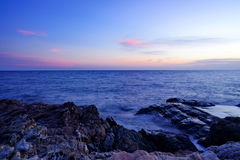 Sunset over the sea. Sunset over the blue sea with clear sky royalty free stock images