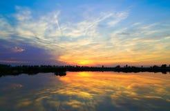 Sunset over the lake. Sunset over the lake clouds sky Stock Image