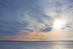 sunset over the lake covered with ice Royalty Free Stock Images