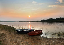 Sunset over the lake. Decline landscape over the lake Stock Image