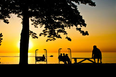 Sunset Over Lake Erie. People enjoying a beautiful sunset over Lake Erie stock photography