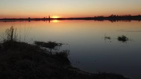 Sunset over a lake stock video footage