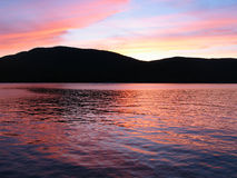 Sunset over lake george New York. Sunset over Lake George in New York state, red sky at night and purple hues, all colors are natural without filters royalty free stock photo