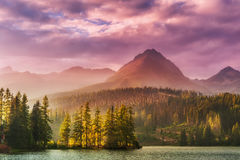 Sunset over a lake in high mountains Stock Photo