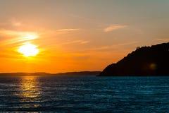 Sunset over Mackinac Island Michigan. Sunset over Lake Huron sailing away from Mackinac Island in Michigan Stock Photo