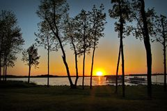 Sunset over Lake Irving in Bemidji Minnesota. With shore and boat dock stock photos
