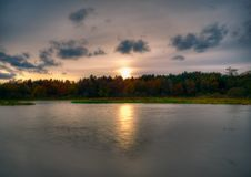 Sunset over Lake. Late afternoon at a small lake stock images