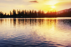 Sunset over the lake. Majestic mountain  in National Park Hi Stock Images