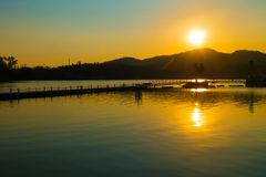 The sunset over the lake and the mountains in Thailand. Stock Image