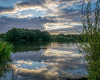 Sunset over lake near Guildford Royalty Free Stock Images
