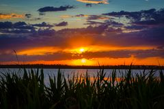 Sunset over lake stock images