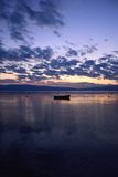 Sunset over a lake. (Ohrid, Macedonia) with a boat in the foreground Royalty Free Stock Images