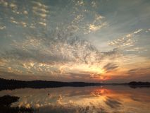 Sunset over the lake with reflexion. And beautiful sky Stock Photography