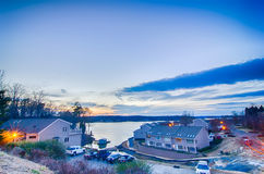 Sunset over lake and residential area at lake Stock Image