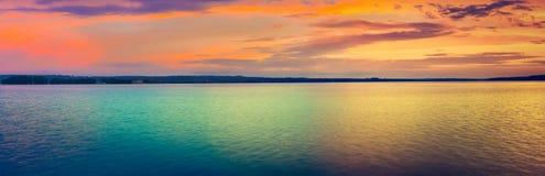 Sunset over the lake. Amazing panorama landscape Stock Photography