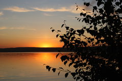 Sunset over the lake in Russia Stock Images