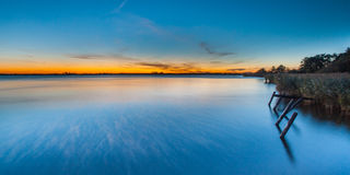 Sunset over Lake Schildmeer, Netherlands Royalty Free Stock Photos