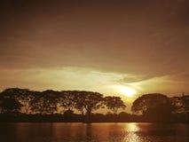 Sunset over the lake. Sepia tone Royalty Free Stock Image