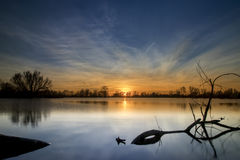 Sunset over a lake Stock Photography