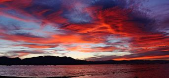 Sunset over lake. Sun setting over lake tahoe, Autumn sky picture taken next to water. Pink sky Stock Photography