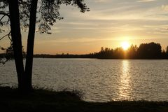 sunset over the lake Valdai stock photos
