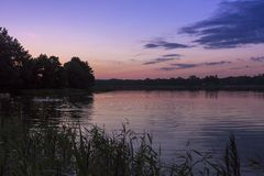 Sunset over the lake, Wigry. Poland. Royalty Free Stock Photos