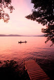 Sunset over Lake Winnipesaukee, NH with canoe Royalty Free Stock Image